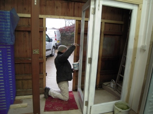 Andy painting the entrance doors